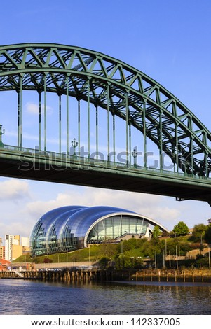 GATESHEAD, ENGLAND - MAY 16:  The Tyne Bridge connecting Newcastle and Gateshead in North East England.  Behind is the iconic Sage centre for musical education and performance on May 16, 2013