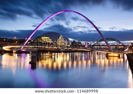 GATESHEAD, ENGLAND - NOV 28: Gateshead Millennium Bridge on November 28th, 2011in Gateshead, England.The bridge design is the result of a competition held in 1996, won by Wilkinson & Eyre Architects
