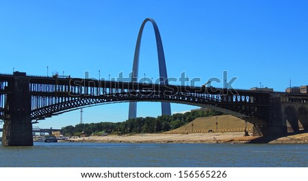 Gateway arch and eads bridge as seen from the Mississippi River, in     st louis, missouri       - stock photo