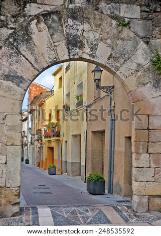 Gateway at old town. picture in retro style - stock photo