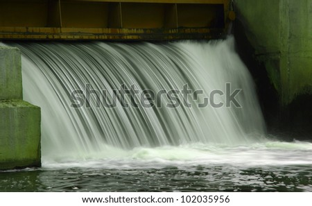 Gateway is open to drain the water. discharge of water for further purification. - stock photo