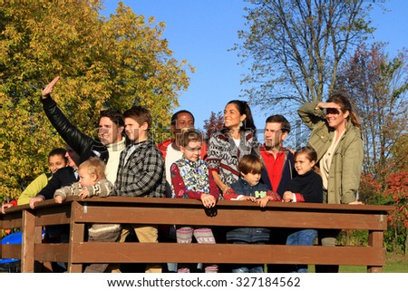 GATINEAU, QUEBEC, CANADA - OCTOBER 13, 2015: Liberal leader Justin Trudeau waving with his family with supporters on a farm wagon.  - stock photo