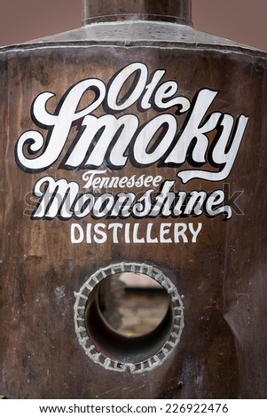 GATLINBURG, TENNESSEE - OCTOBER 20: Ole Smoky Tennessee Moonshine Distillery sign along the Parkway on October 20, 2014 in Gatlinburg, Tennessee - stock photo