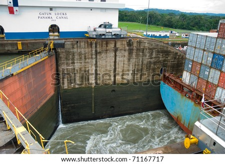 Gatun locks. A cargo ship is leaving the lock. Panama canal - stock photo