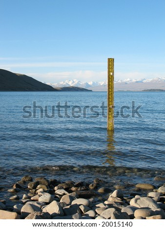Gauge measuring low lake levels - stock photo
