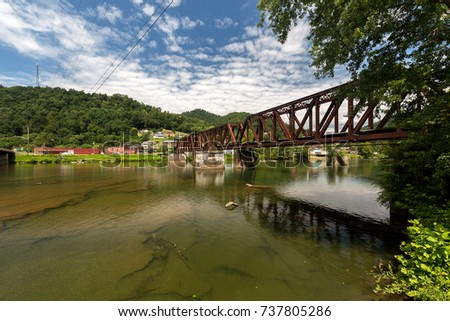 Gauley Bridge, West Virginia - 6 August, 2017: Bridges cross the Gauley River on a summer day on 6 August, 2017 in this small West Virginia town.
