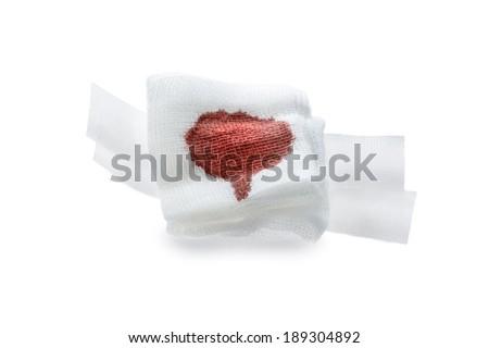 Gauze bandage with blood  on white. - stock photo
