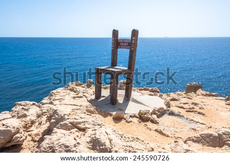 GAVDOS, GREECE - SEPTEMBER 25. An oversized chair as sculpture at Kap Trypiti on Gavdos on September 25, 2014. Kap Trypiti is the most southern point of Europe.  - stock photo
