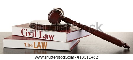 Gavel and books on wooden table on white background - stock photo