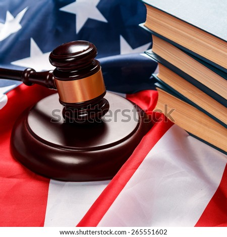 Gavel and books over american flag - stock photo