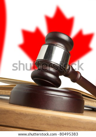Gavel  and Flag of Canada - stock photo