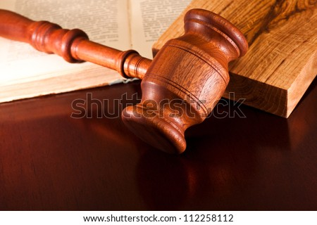 Gavel and law book on a table judge - stock photo