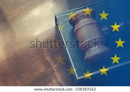 Gavel and legal book on wooden table, collage with european union flag - stock photo