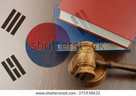 Gavel and legal book on wooden table, collage with flag of south korea - stock photo