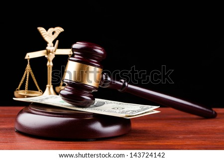 gavel and money isolated on black