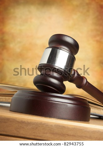 Gavel and old book - stock photo