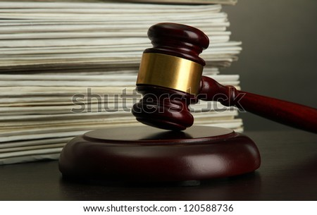 gavel and old papers on grey background - stock photo
