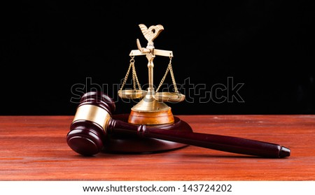 gavel and scale of justice isolated on black - stock photo