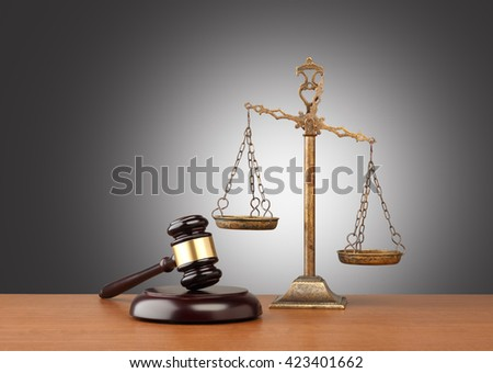 Gavel And Scales Of Justice  On Desk
