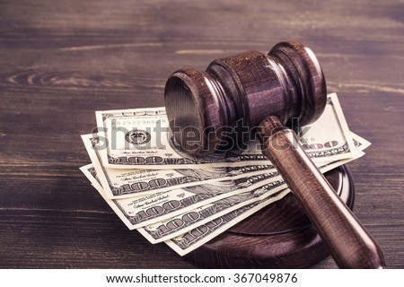 Gavel and some dollars banknotes.Auction bidding, judicial system corruption concept.Toned - stock photo
