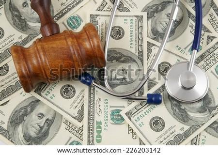 stock-photo-gavel-and-stethoscope-on-dol