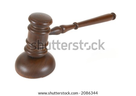 gavel close up on white background with shallow dof