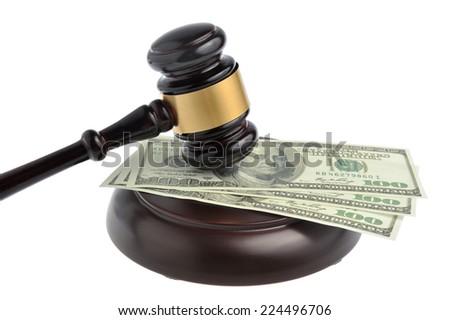Gavel judge with money isolated on white background - stock photo