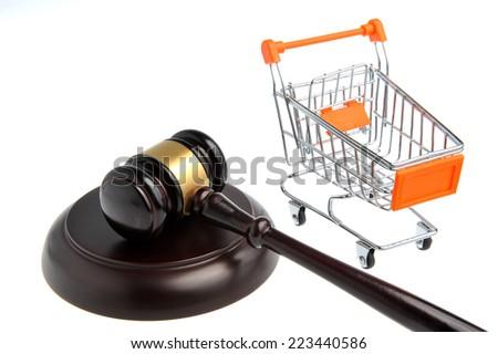 gavel of judge with pushcart isolated on white background - stock photo