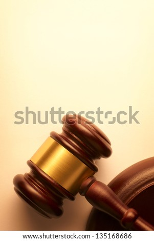 gavel on a brown gradient background - stock photo