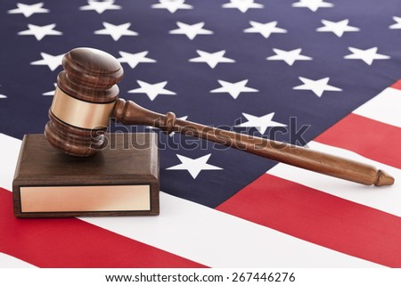 Gavel on american flag - stock photo