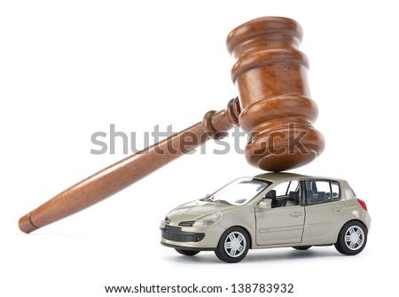 Gavel on car isolated on white background - stock photo