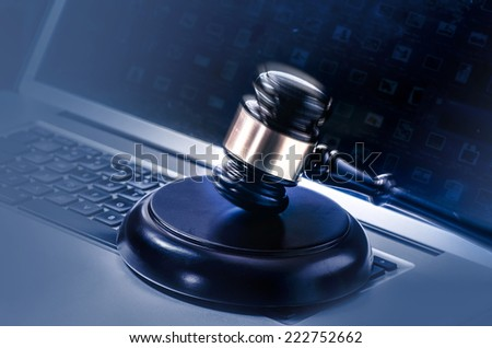 Gavel on Computer - cyber law crime concept image.  - stock photo