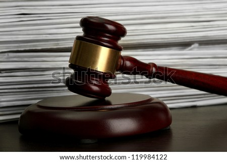 gavel on old papers background - stock photo