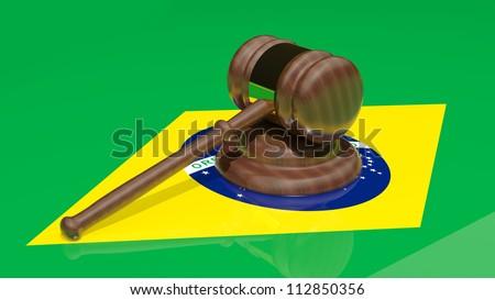 Gavel on the flag of Brazil - stock photo
