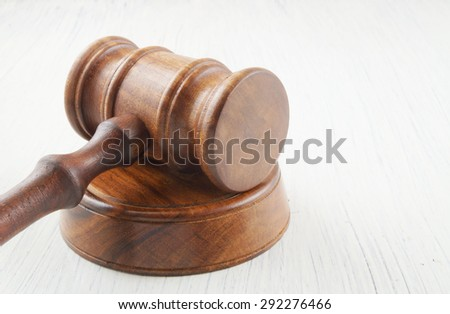 Gavel on white table with room for text - stock photo