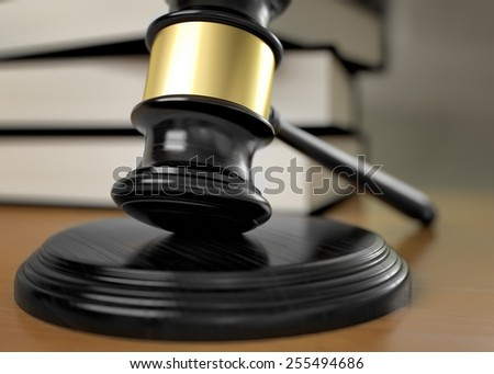 gavel on wooden table - stock photo