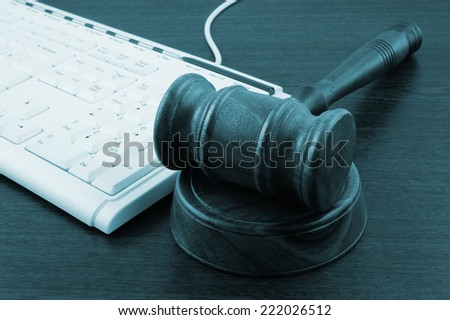 Gavel with computer keyboard close up - stock photo