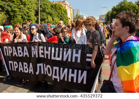 "Gay activists with broadsheet ""Minority rights = human rights"" at Kiev pride gay parade, 12.06.2016 - stock photo"
