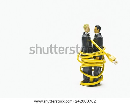 Gay Couple Wrapped in Cable - stock photo