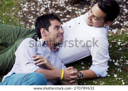Gay men relaxing in the park - stock photo