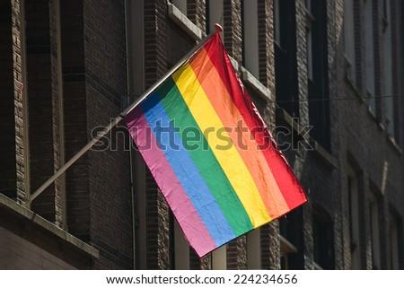 Gay rainbow flag on a facade.  - stock photo