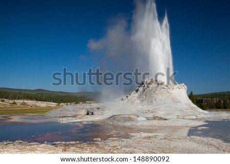 Gayser eruption in Castle Geyser in the Yellowstone National Park - stock photo