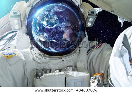 Gazing Astronaut - Elements of this Image Furnished by NASA