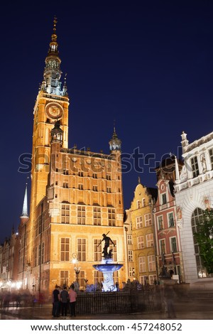 Gdansk by night in Poland, Old Town, Long Market, illuminated Main Town Hall and Neptune Fountain - stock photo