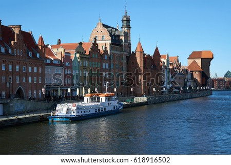 GDANSK, POLAND - APRIL 6, 2017: View of the riverside in Old Town by the Motlawa river, Gdansk is located in northern Poland and is a very popular tourist  destination