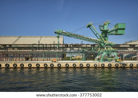 Gdansk, Poland. chemical wharf, loading vessel - stock photo