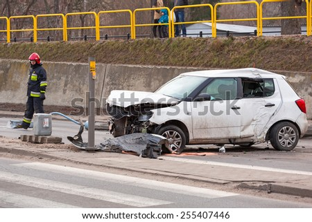 GDANSK, POLAND - FEBRUARY 21, 2015: The scene of a car crash on the road of Gdansk, Poland. Fire fighters and Police helping with a car traffic. - stock photo