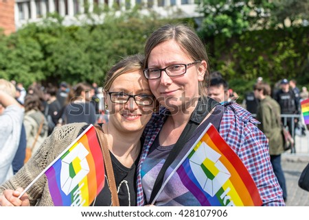 GDANSK, POLAND - MAY 21, 2016: Lesbian couple takes part in Equality March to support LGBT people rights.  - stock photo
