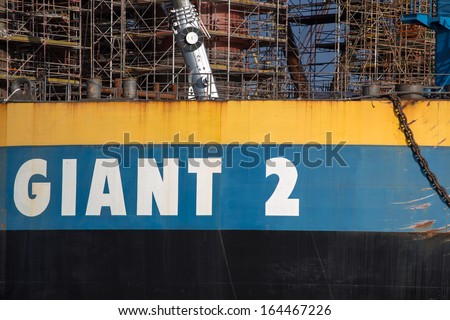 GDANSK, POLAND, SEPTEMBER 19: Docking oil rig at the Gdansk Shipyard under construction with a clear blue sky in the background. The oil rig weights 12 thousand tons. Gdansk, Poland, 2013 - stock photo