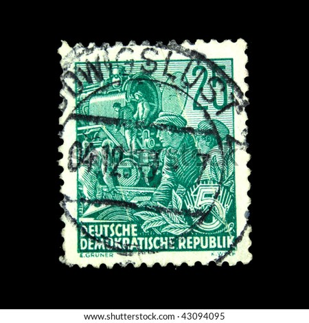 GDR - CIRCA 1958: A stamp printed in GDR (East Germany) shows workers on the plant, circa 1958